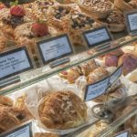 pastry case showing different types of pastries with labels