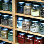 glass jars on shelf filled with spices