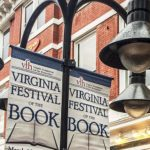 black light post with three lights and white sign with the words Virginia Festival of the Book in black