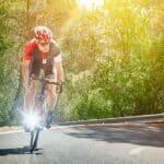 Biker on hill in sunshine